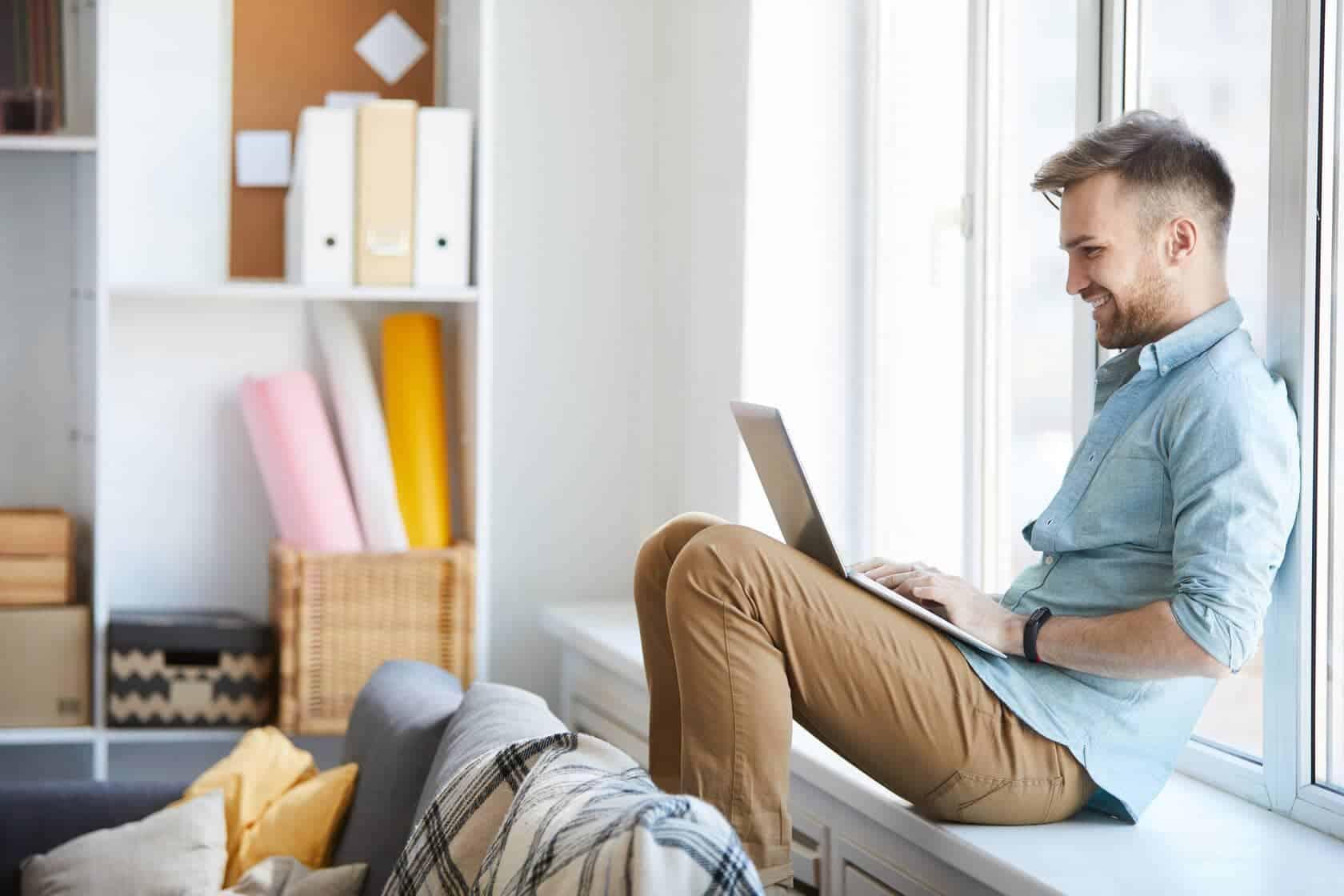 Guy Using Laptop Lauging