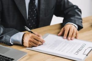 A man signing legal loan contract